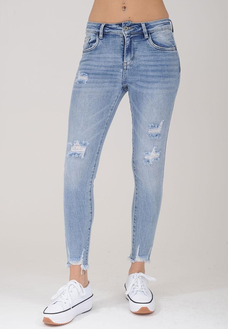 Jeans slim femme bleu foncé effilé sur le bas déchiré